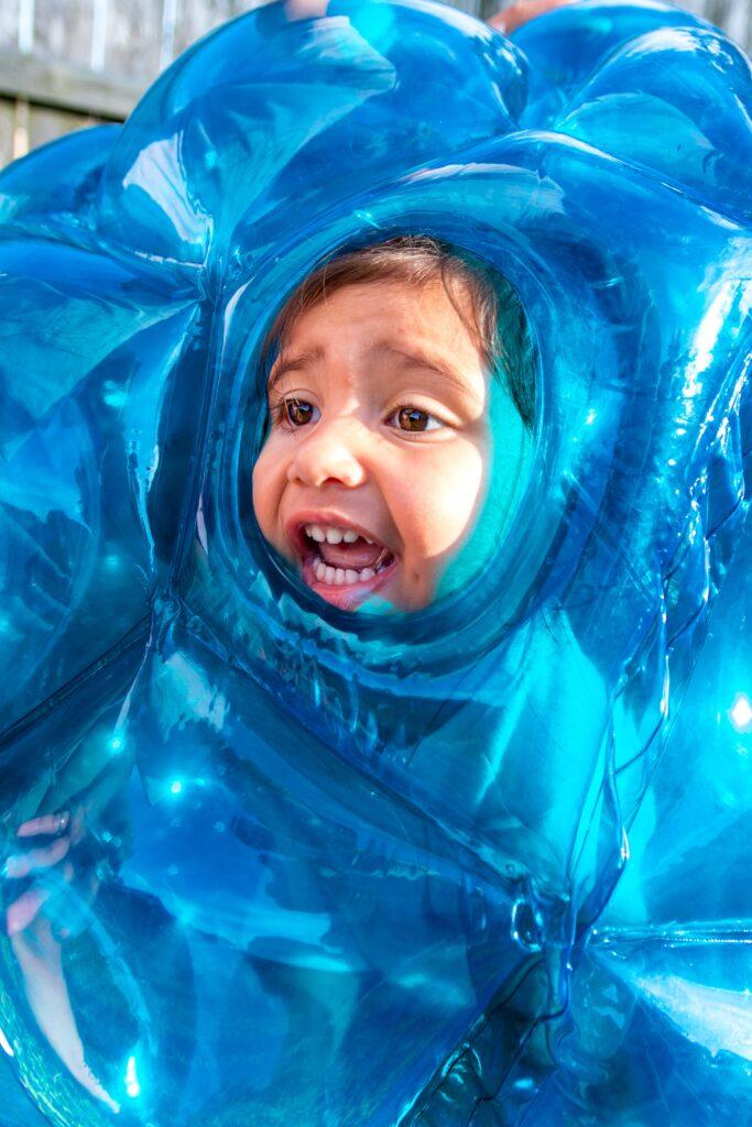 Child in Blue Bubble Suit - Form Fitness Pilates